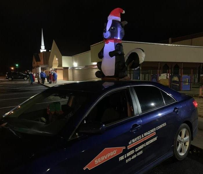 Our SERVPRO car with Lilly our mascot ready to go in the Pryor Christmas Parade.
