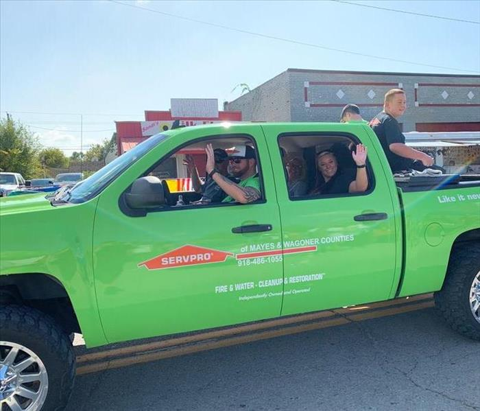 Our production manager Kyle and Franchise owner Jarod driving the SERVPRO truck through the Chouteau Days Parade.