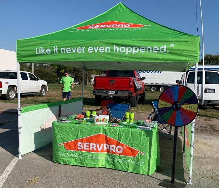 Our tent and prize wheel with swag set up for the Chouteau Days in Salina.